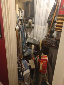 A closet full of antique vacuum cleaners.