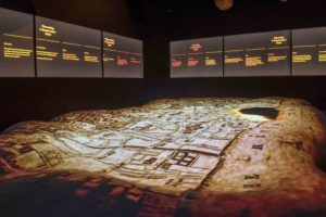 Gallery installation with projection on bread (C) Museum of London